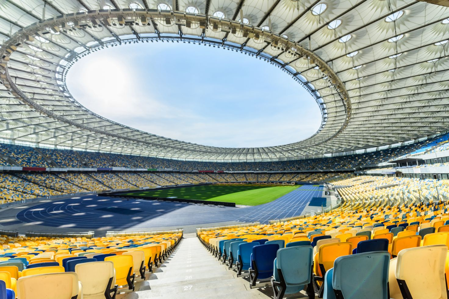 rows-of-yellow-and-blue-stadium-seats-on-soccer-fi-T7AKFMB (1)